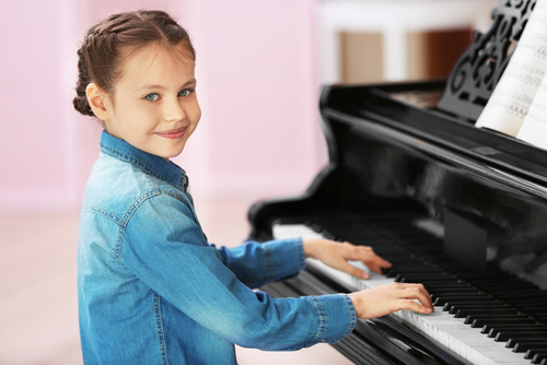 Small Gril Playing Piano